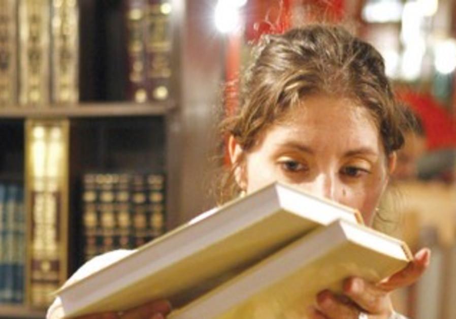 A woman searches through books