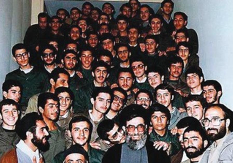 Revolutionary Guards member kisses Khamenei