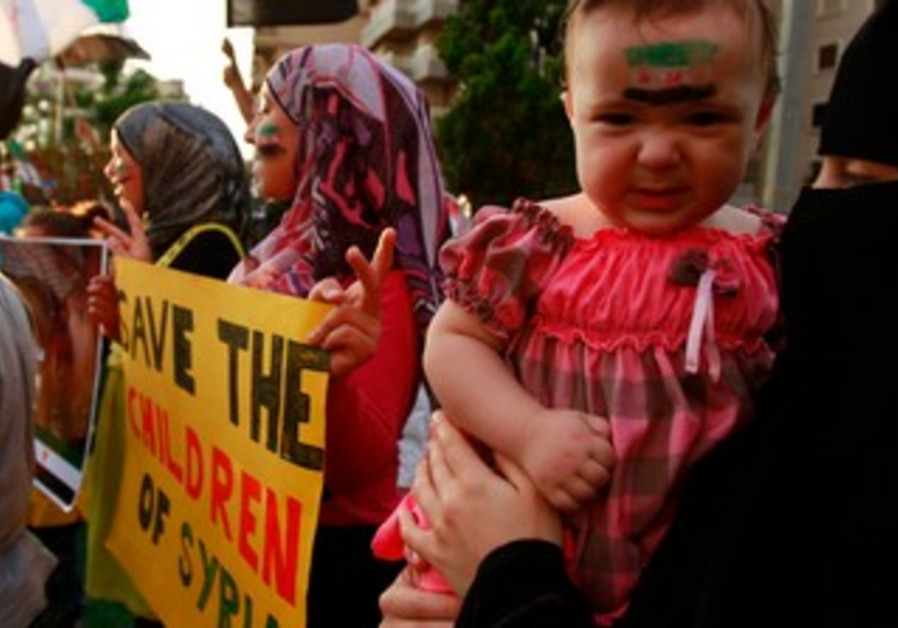 Child with Syrian opposition flag painted on face