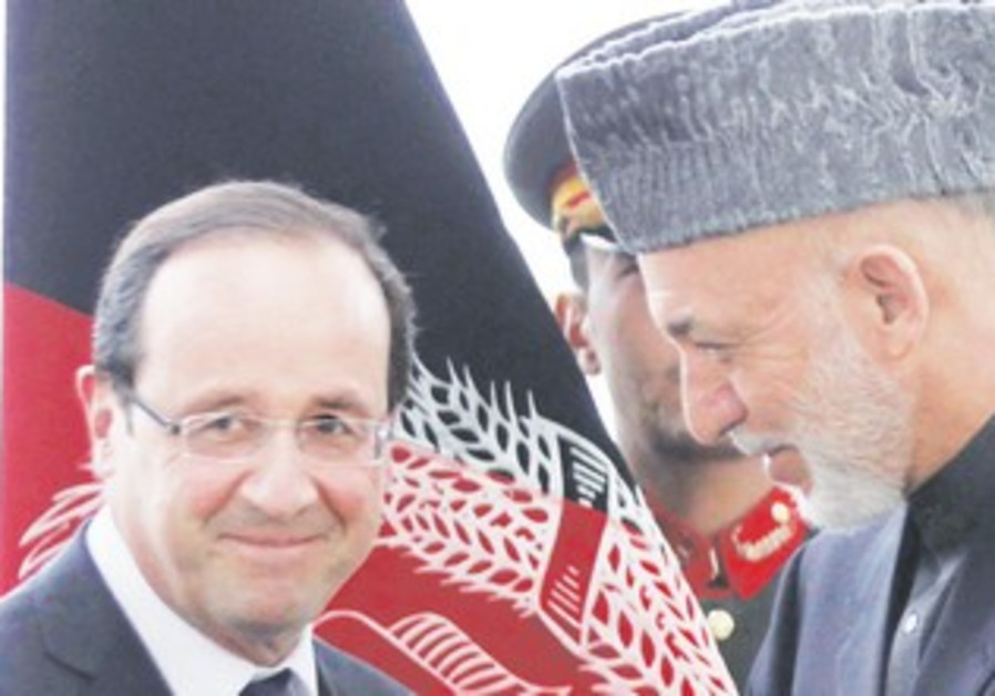 Hollande meets Afghan counterpart, Karzai