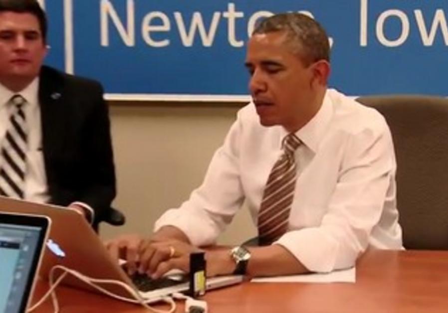 US President Barack Obama Tweeting.