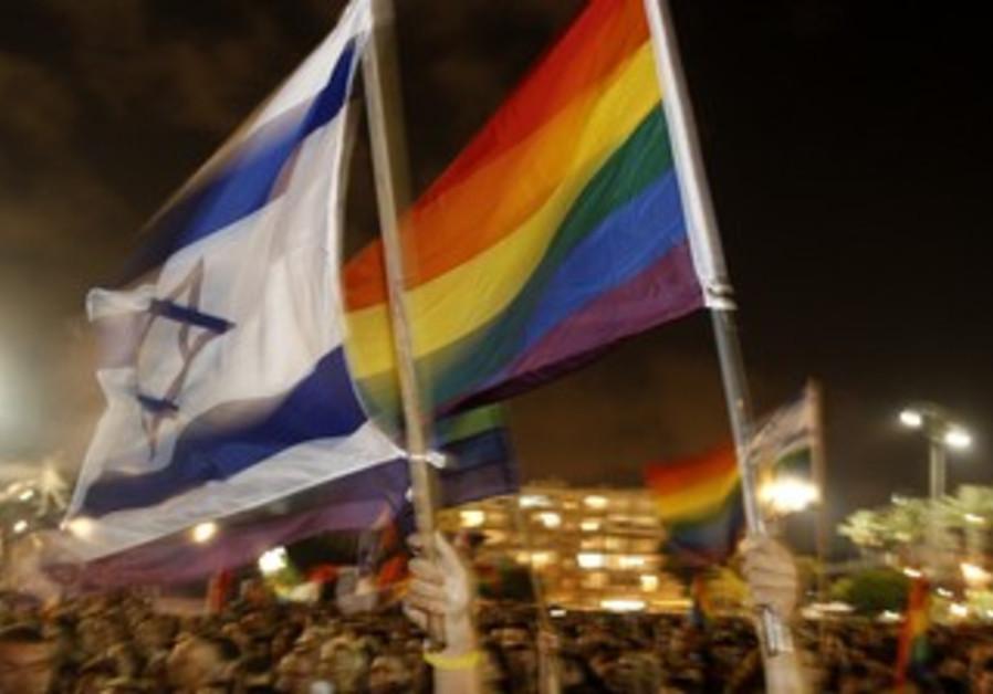 Pride flags being waved next to Israeli flags