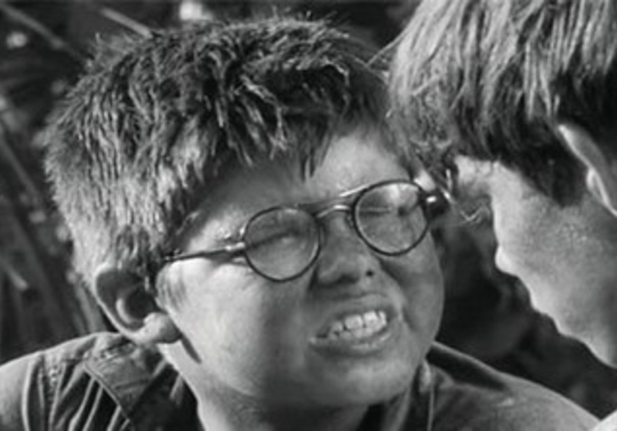 "Hugh Edwards as 'Piggy' in ""Lord of the Flies"""