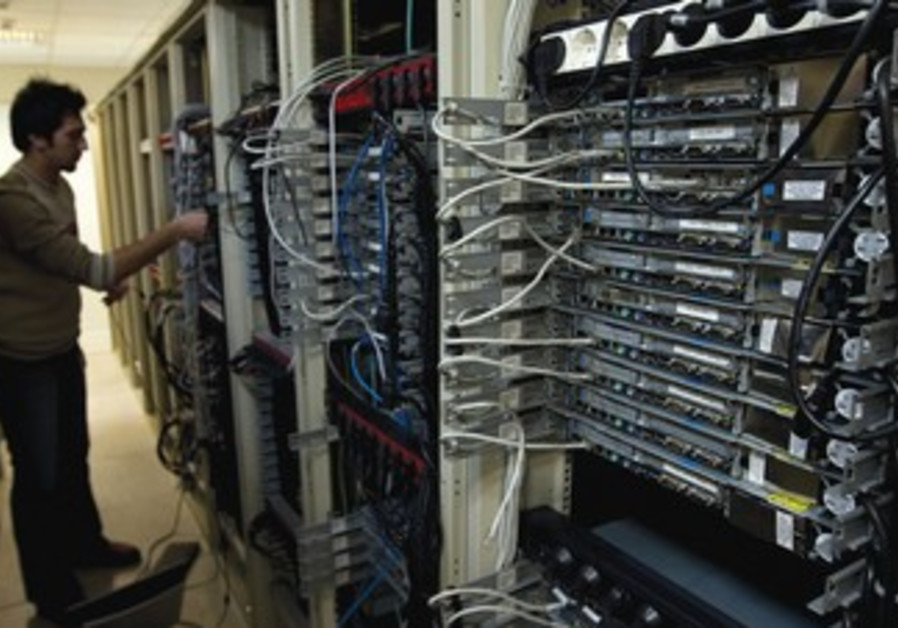 Engineer checks equipment at Tehran internet