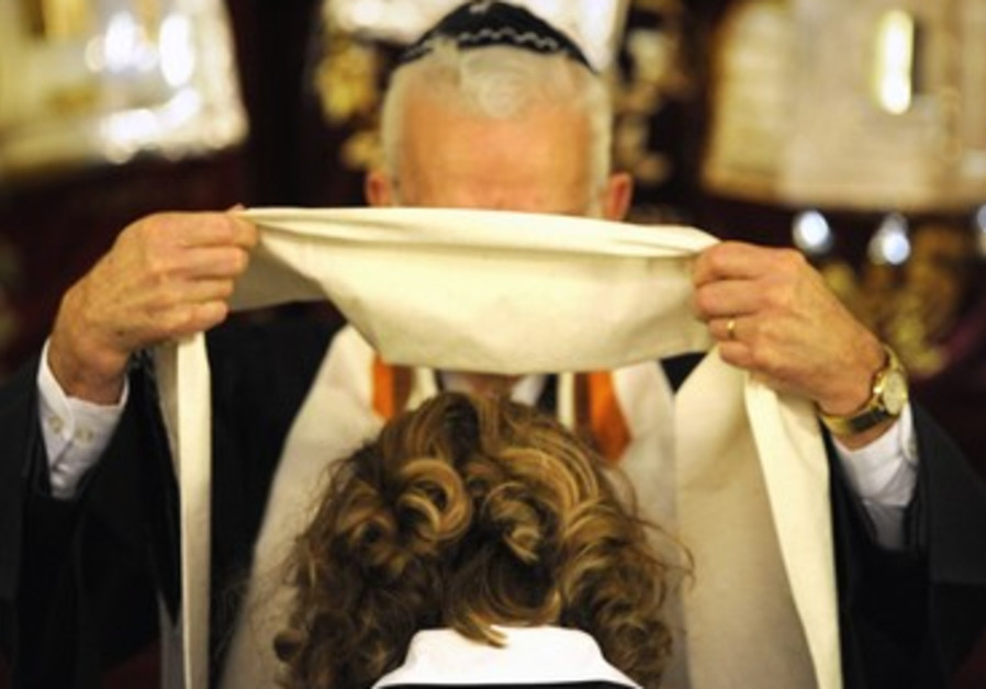 Female rabbi being ordained