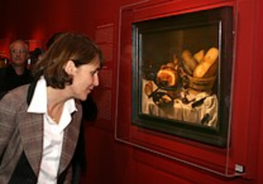 Hoping for a miracle, looted art exhibit opens