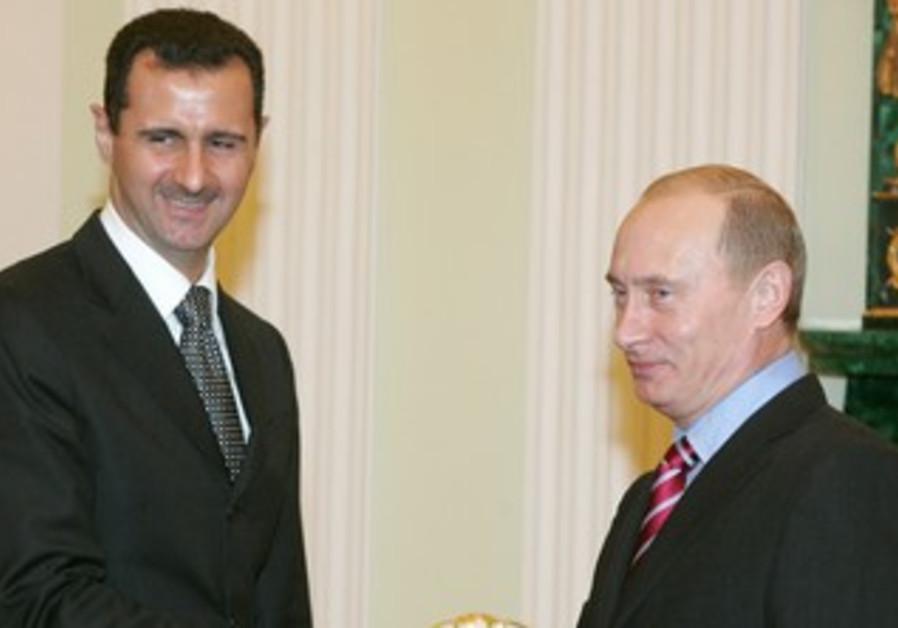 Bashar Assad and Vladimir Putin meet at the Kremlin in Moscow, December 2006.