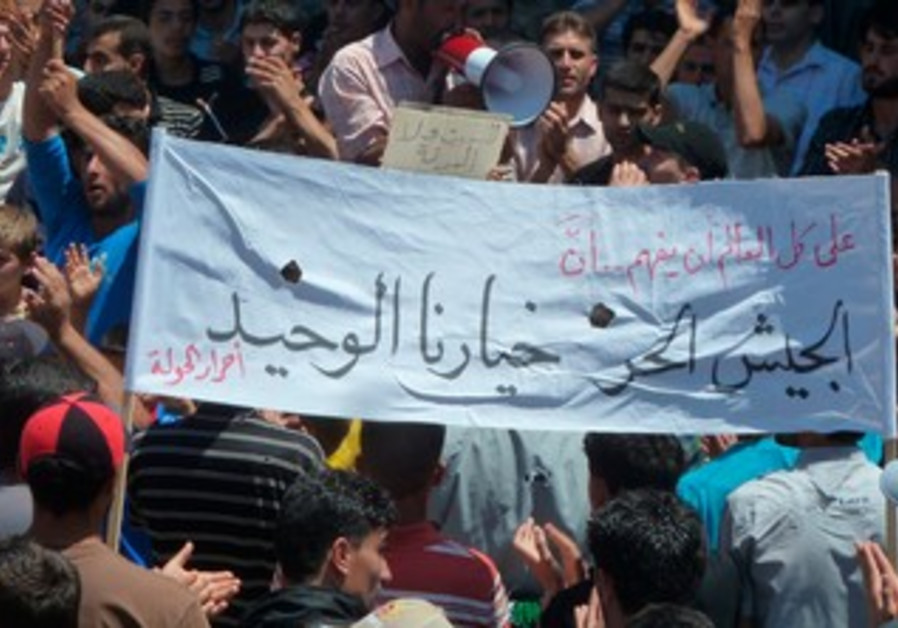 Demonstrators protest against Assad after  prayers