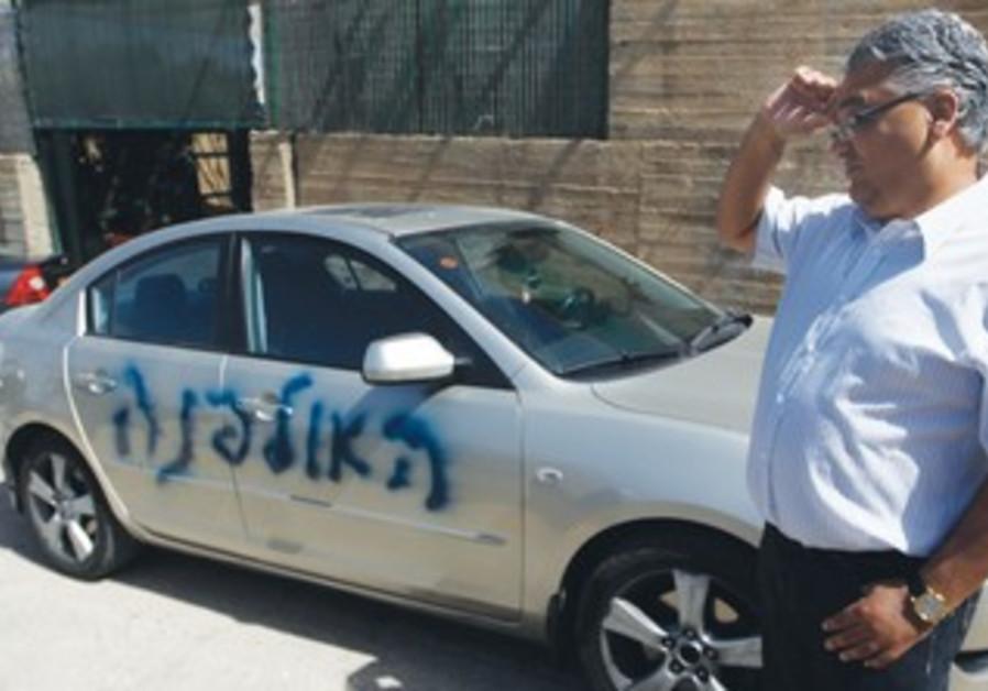 Word 'Ulpana' spray-painted on car in e. J'lem