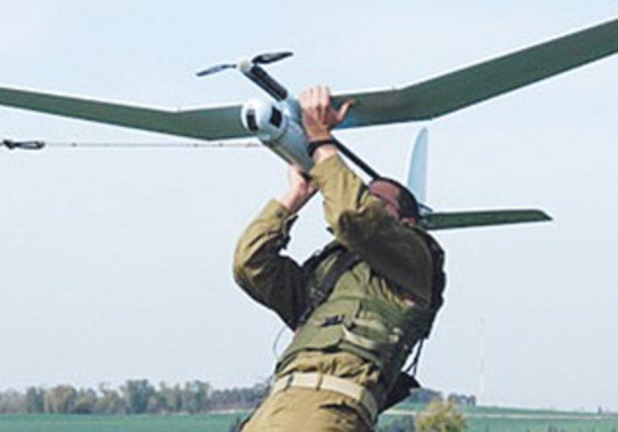 AN IDF soldier launches a Skylark UAV