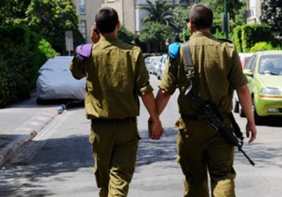 Two male soldiers holding hands in TA