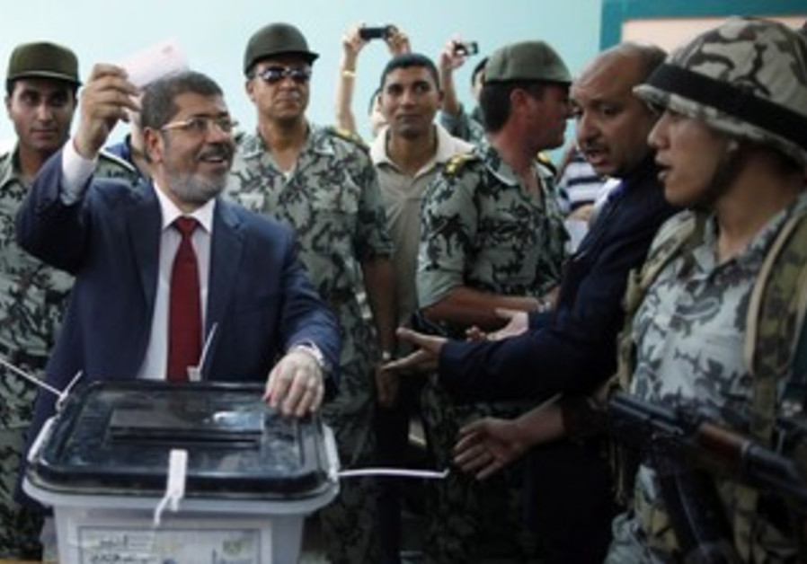 Muslim Brotherhood candidate Mohamed Mursi  votes