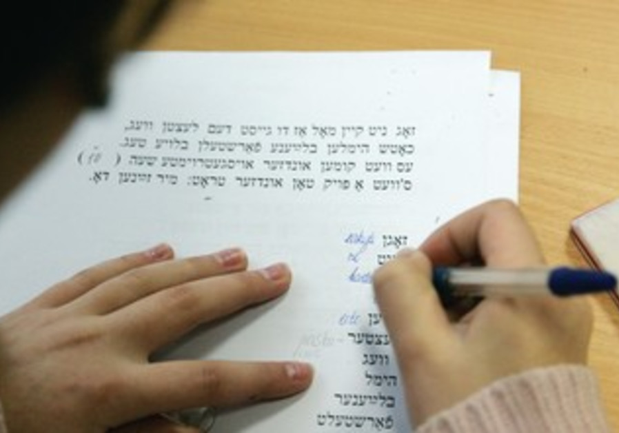 A child studies Yiddish
