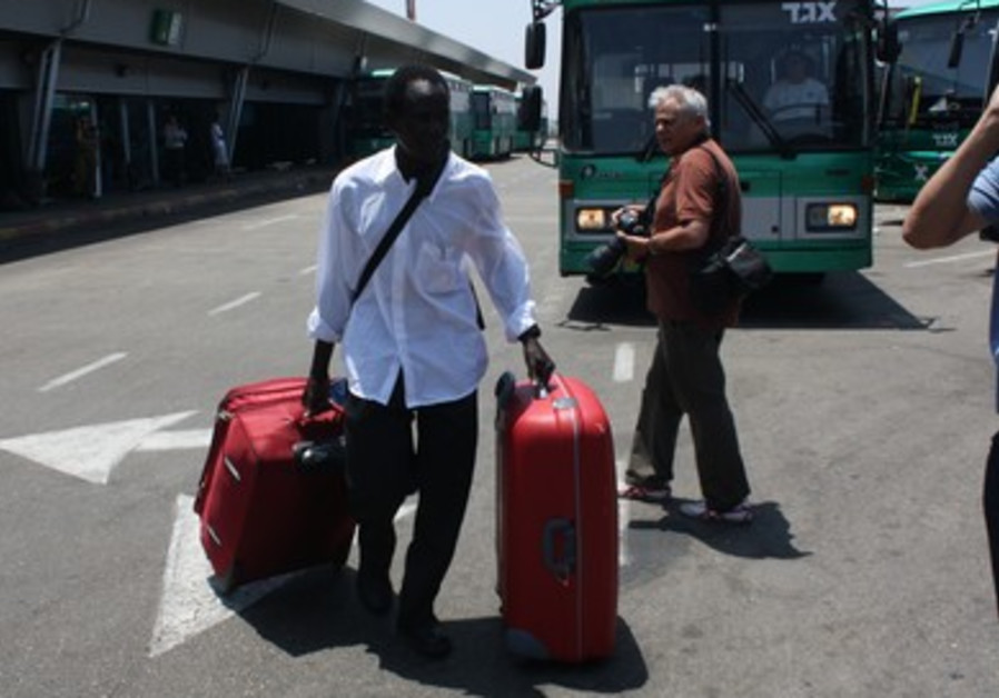 S. Sudanese man with luggage prior to deportation