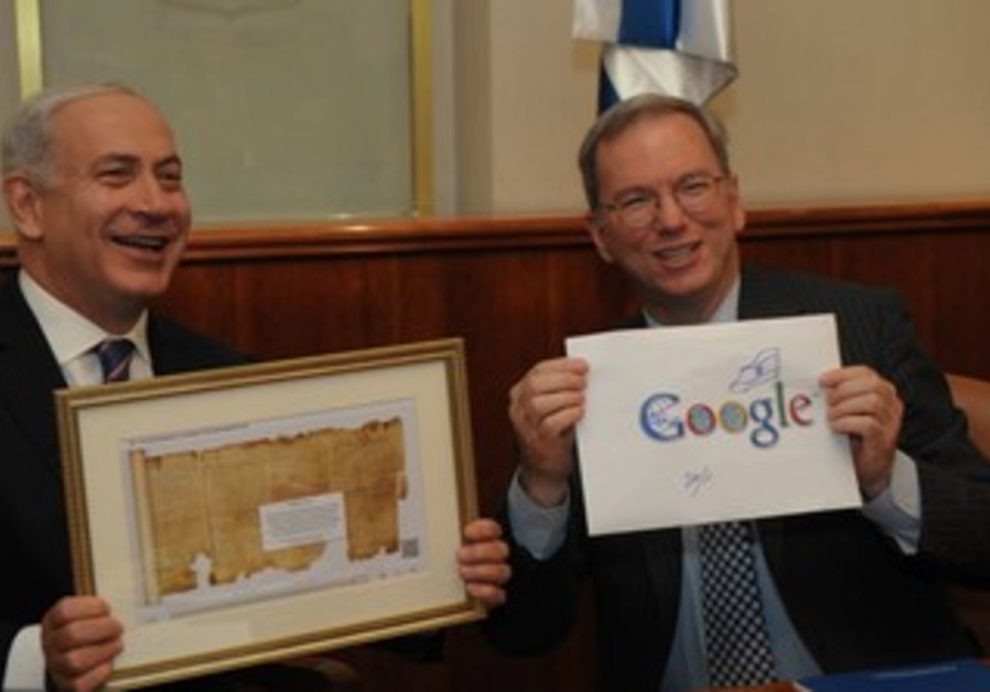 PM, Schmidt hold up Doodle, Isaiah Scroll picture
