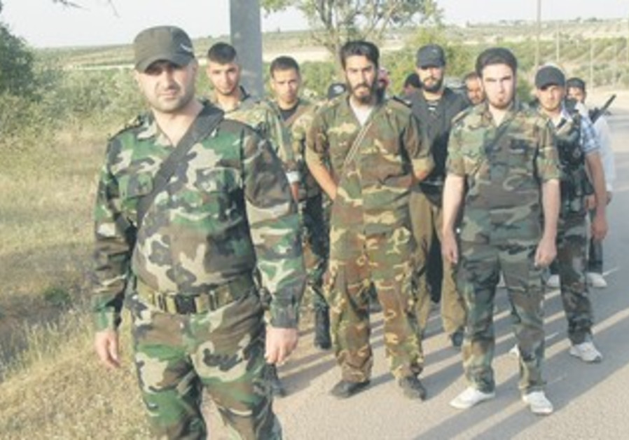Free Syrian Army fighters train in Homs outskirts