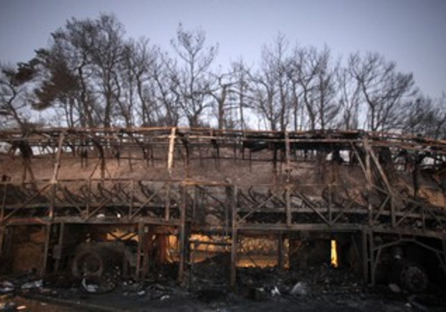 Burned out Prison Service bus from Carmel Fire