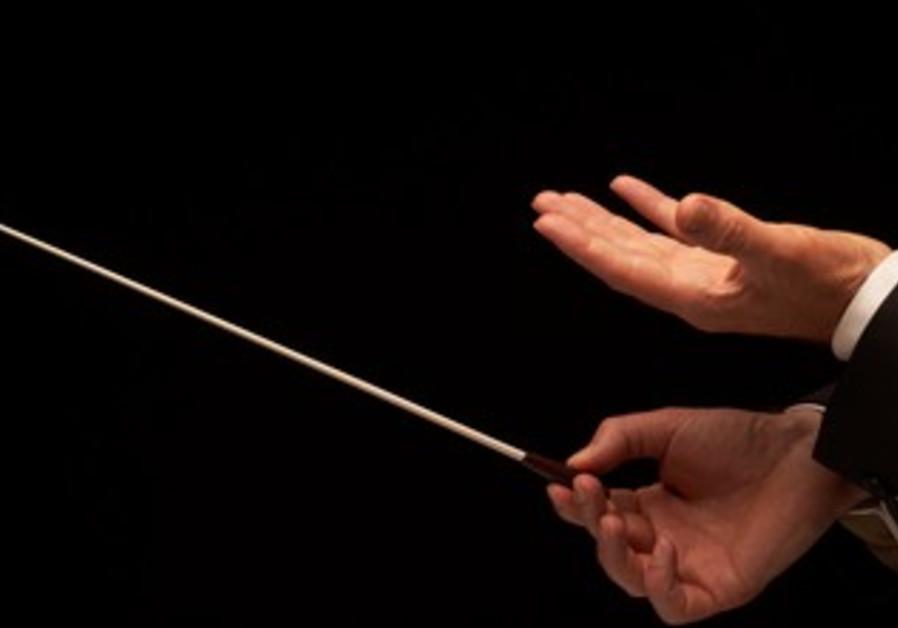 Concert conductor holds baton (illustrative)