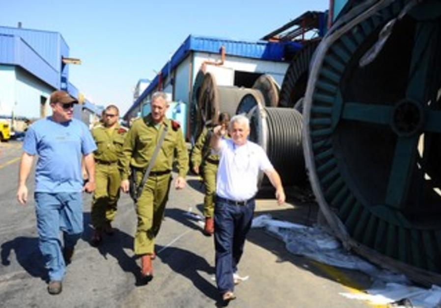 Gantz tours Sderot factory hit by Kassam rocket