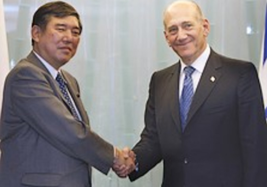 Olmert: Peace deal not definite by end of year