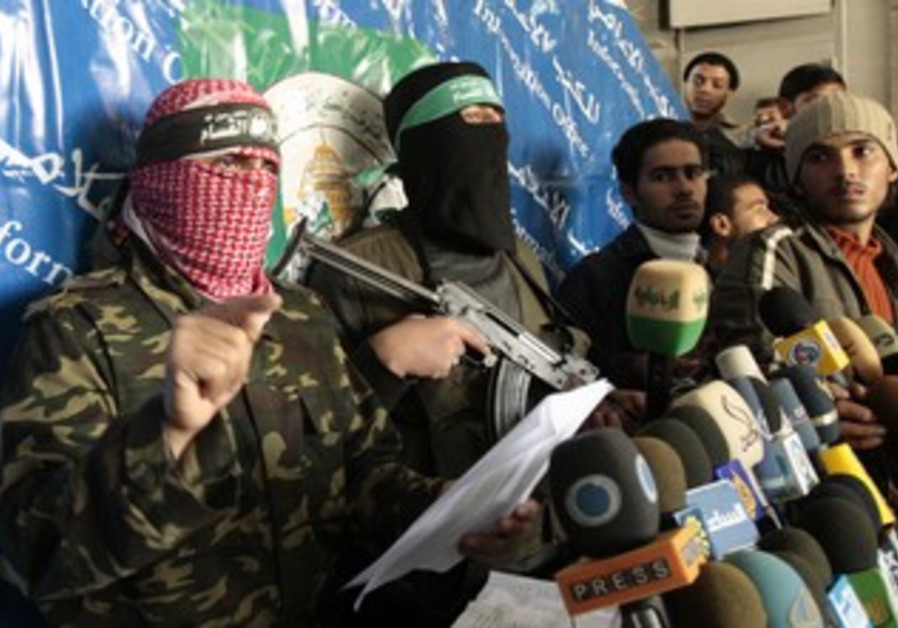 Masked Hamas men hold a press conference [file]