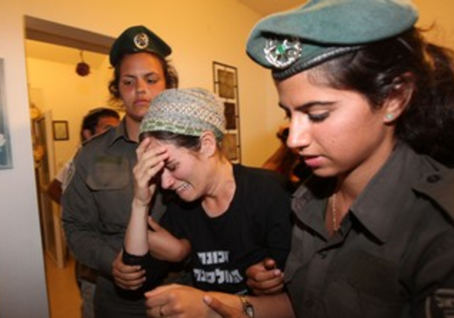 Yiska Fattal led away from Ulpana home