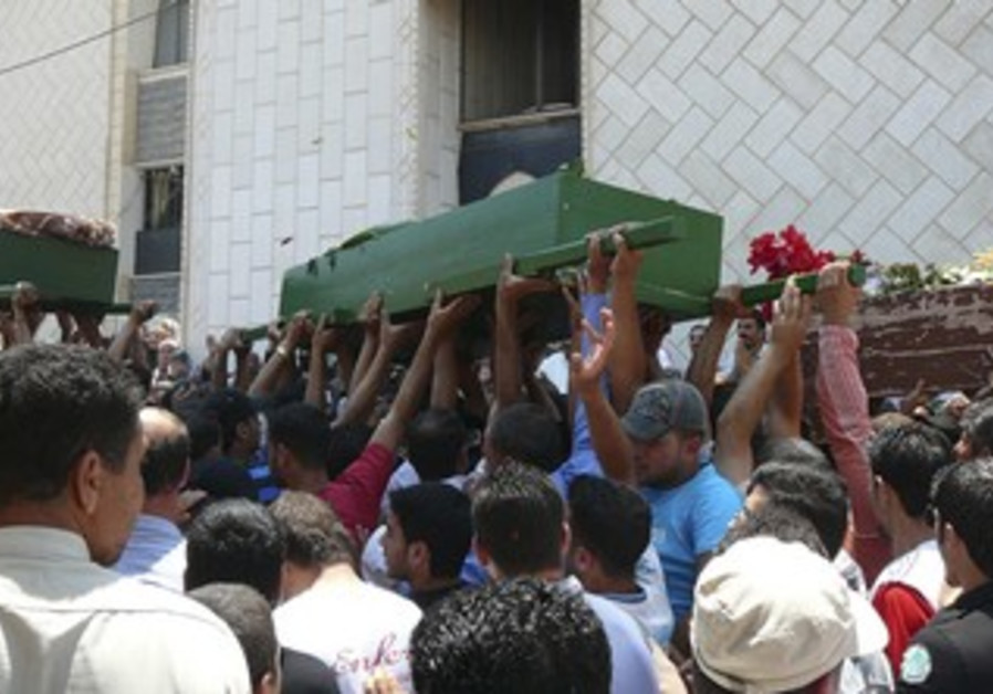 Syrians carry coffins of protesters