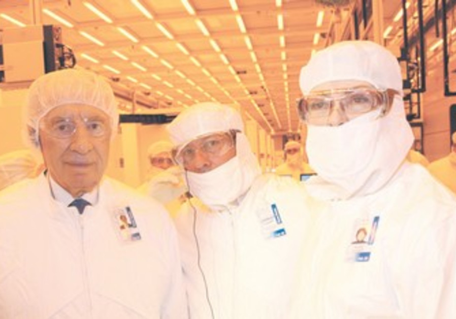 Peres in 'clean room' gear at Intel plant.