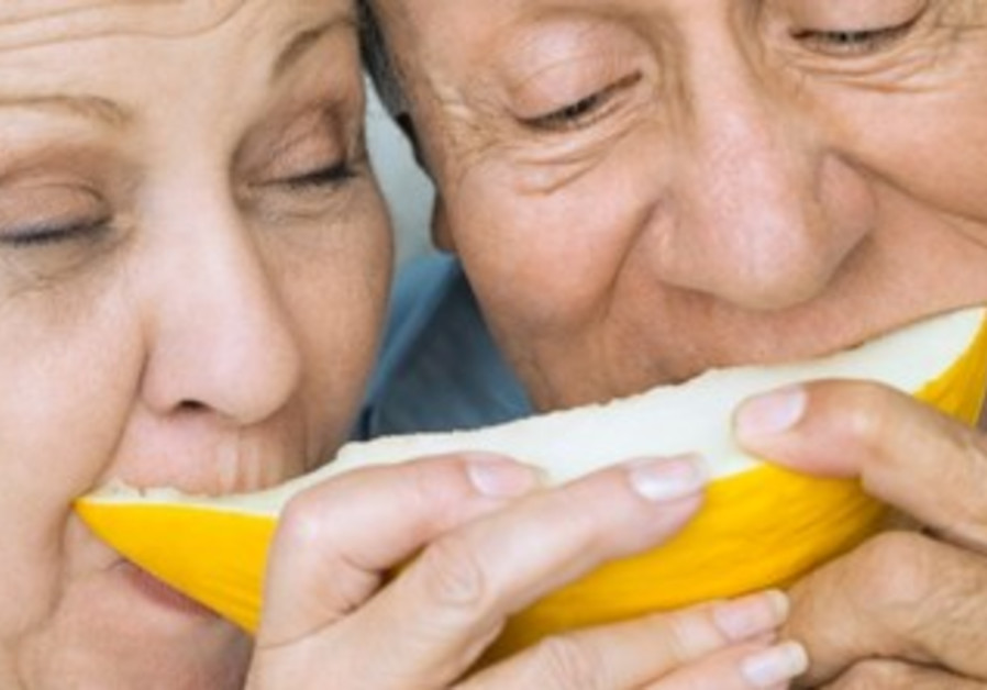 Elderly couple eating fruit [illustrative]