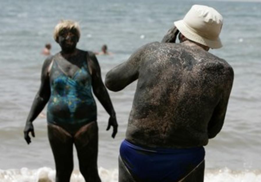 Tourists on Jordanian side of Dead Sea