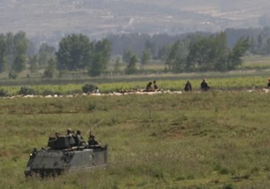 Lebanese soldiers patrol Wadi Khaled