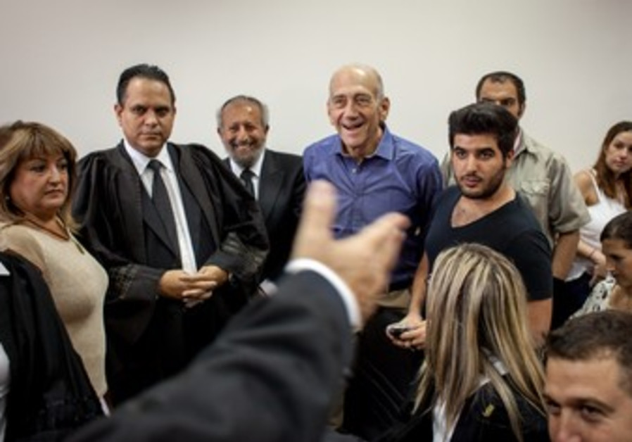 Ehud Olmert rejoices following court verdict