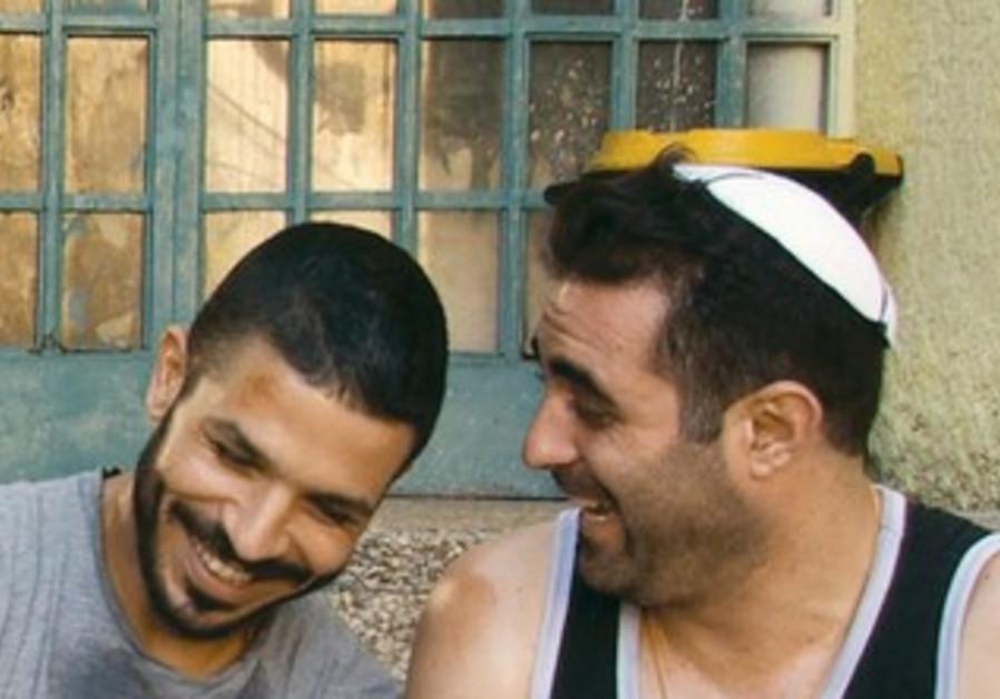 ITZIK GOLAN and Roy Assaf in 'God's Neighbors.'