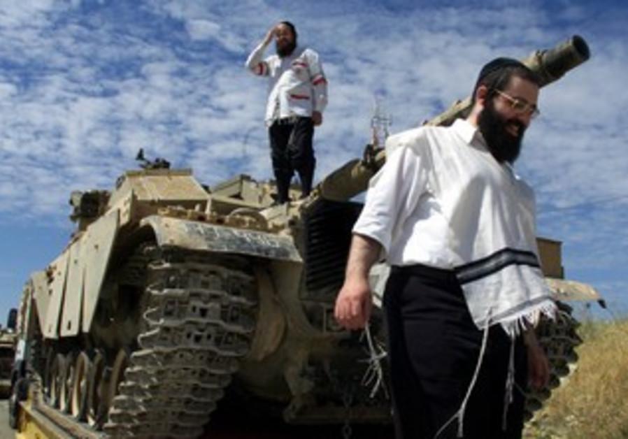 Haredim stand atop IDF Merkava tank