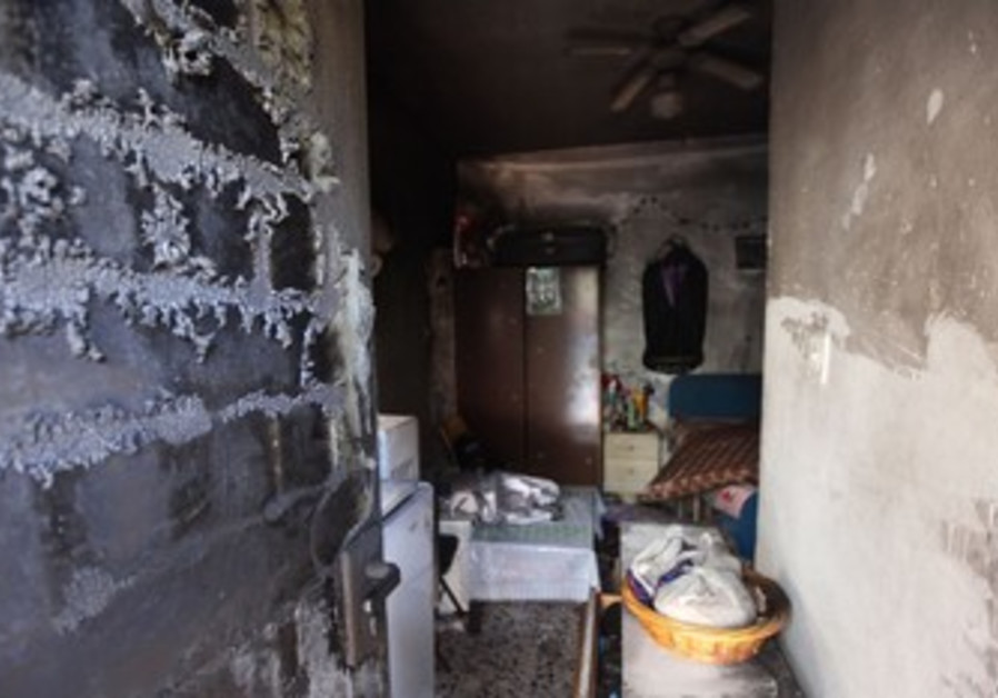 Suspected arson at Eritrean's apartment.