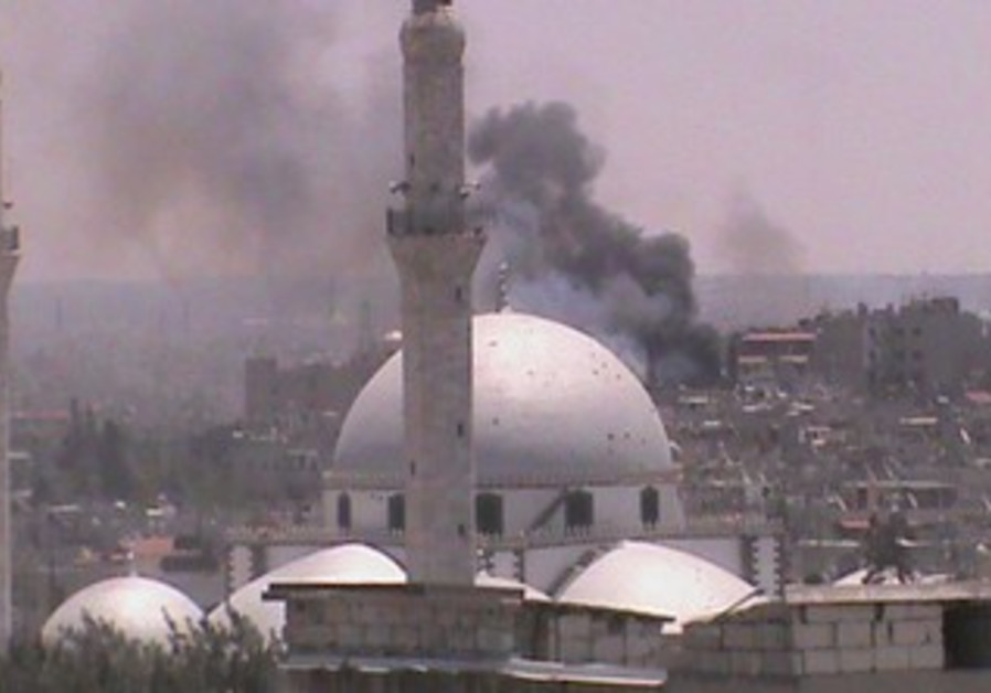 Smoke rises over Syria's Homs [file]