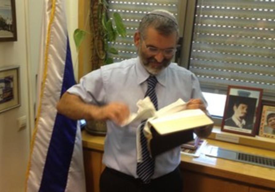 MK Ben-Ari tearing up a New Testament