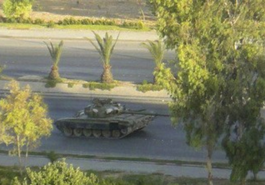 Syrian tank is seen in Damascus