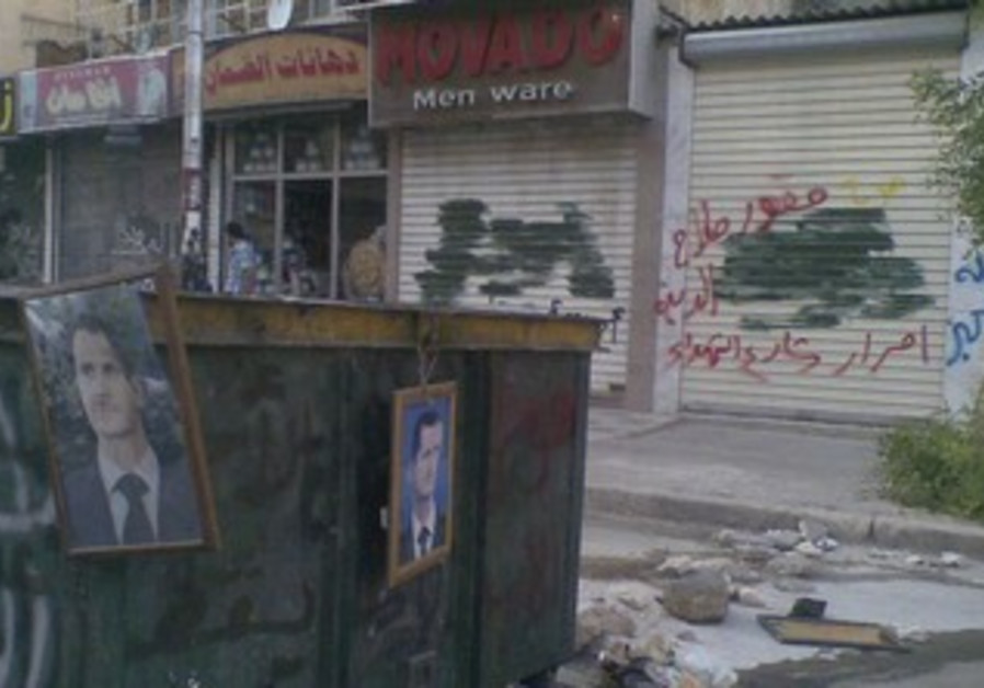 Pictures of Assad hang from garbage bins in Aleppo