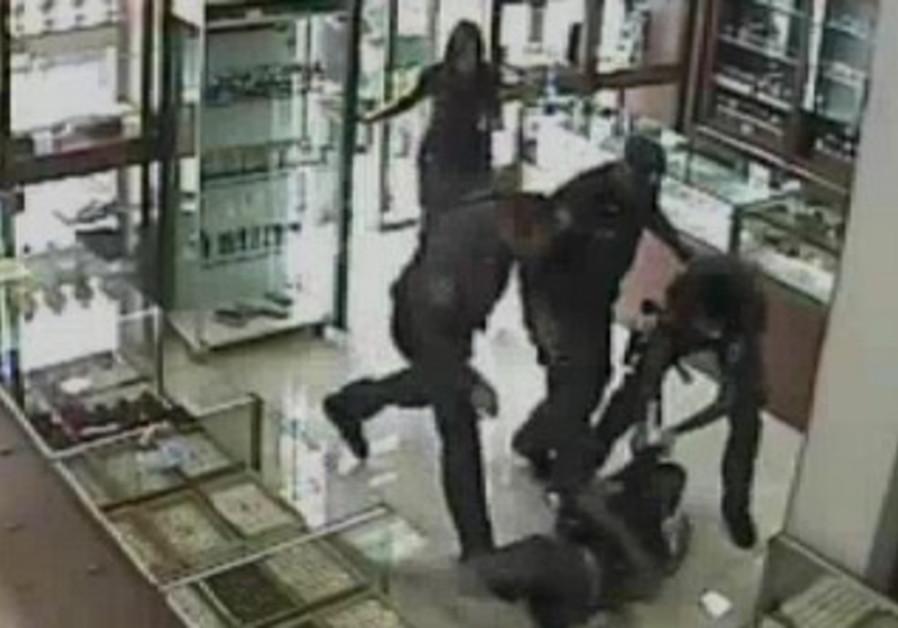 Police kick, tase suspect in store