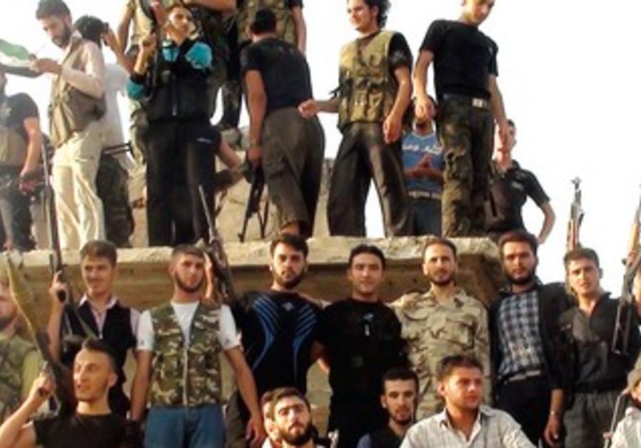 Free Syrian Army members in al-Rasten, near Homs
