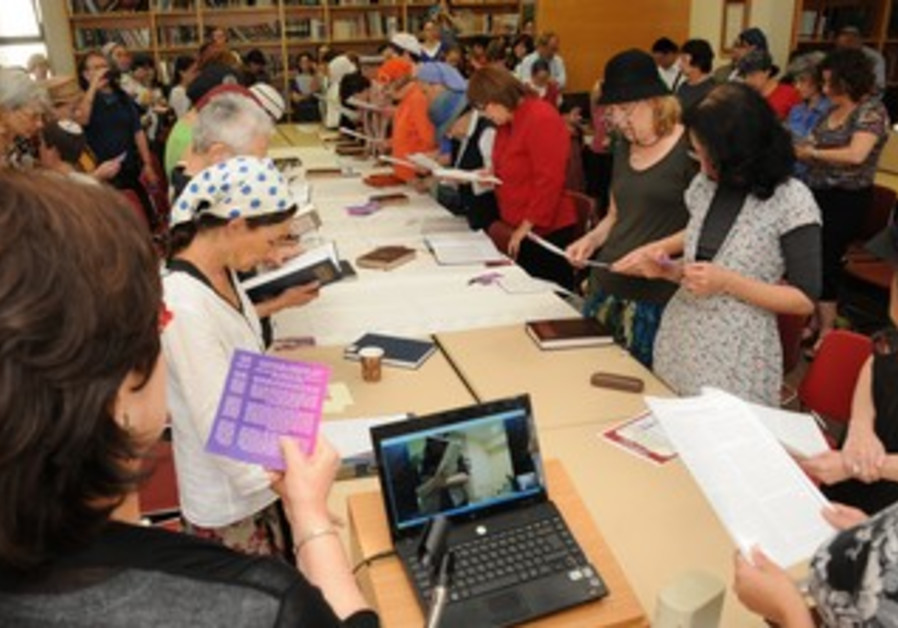 Women study talmud at siyum event
