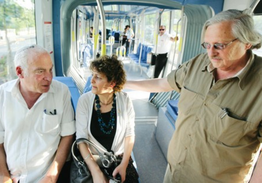 Yael Antebi (center) on the light rail.