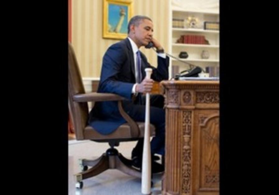Obama hold s baseball bat while talking to Erdogan