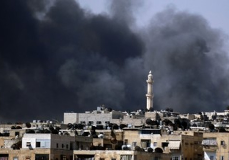 Smoke rises over Aleppo during clashes
