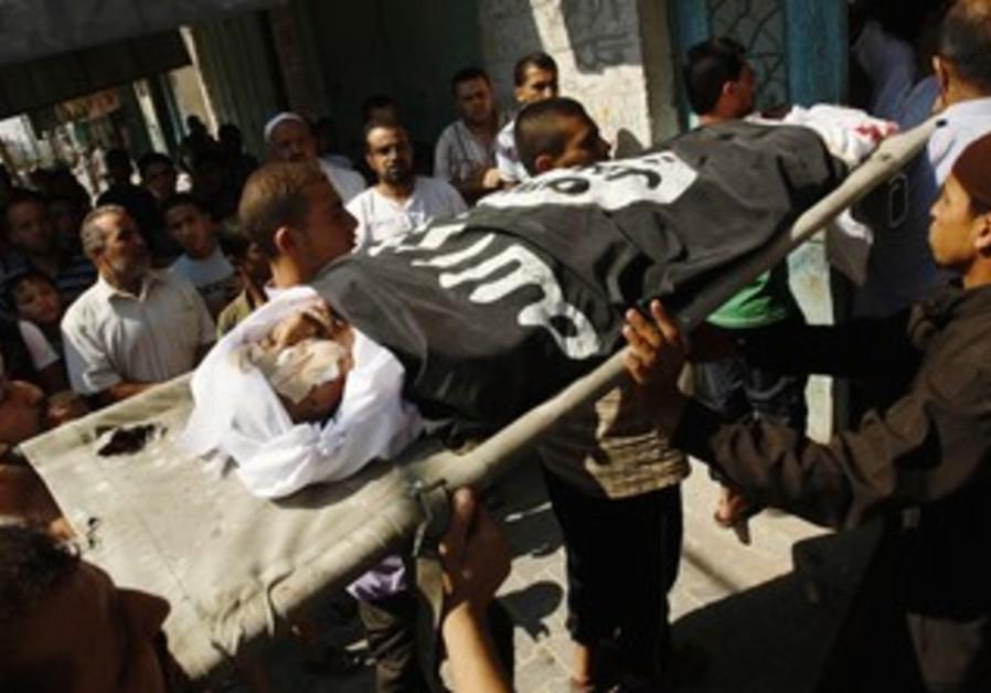 Palestinians carry the body of Eid Hjazi, Rafah.
