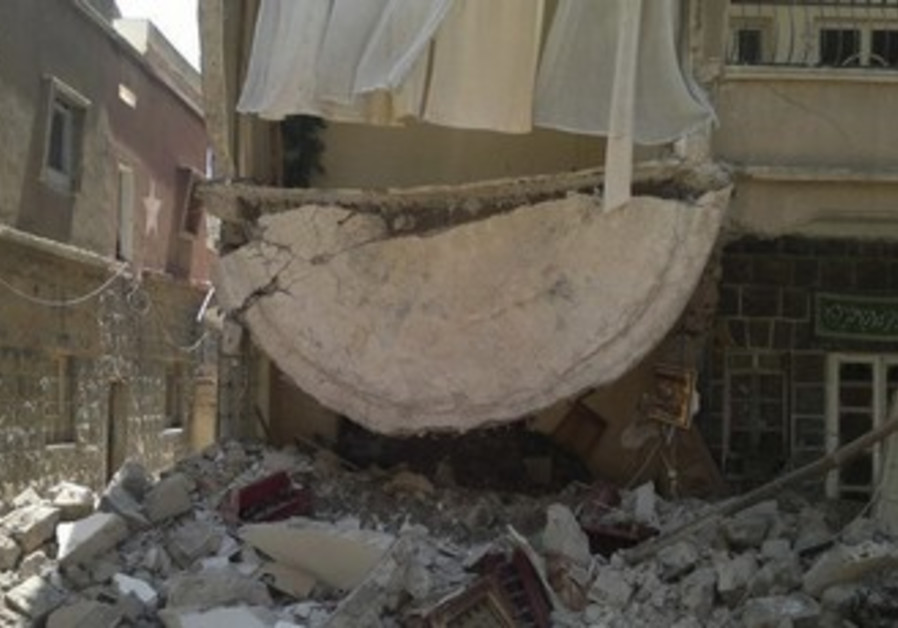 Damaged buildings are seen at Deraa Palestinian re