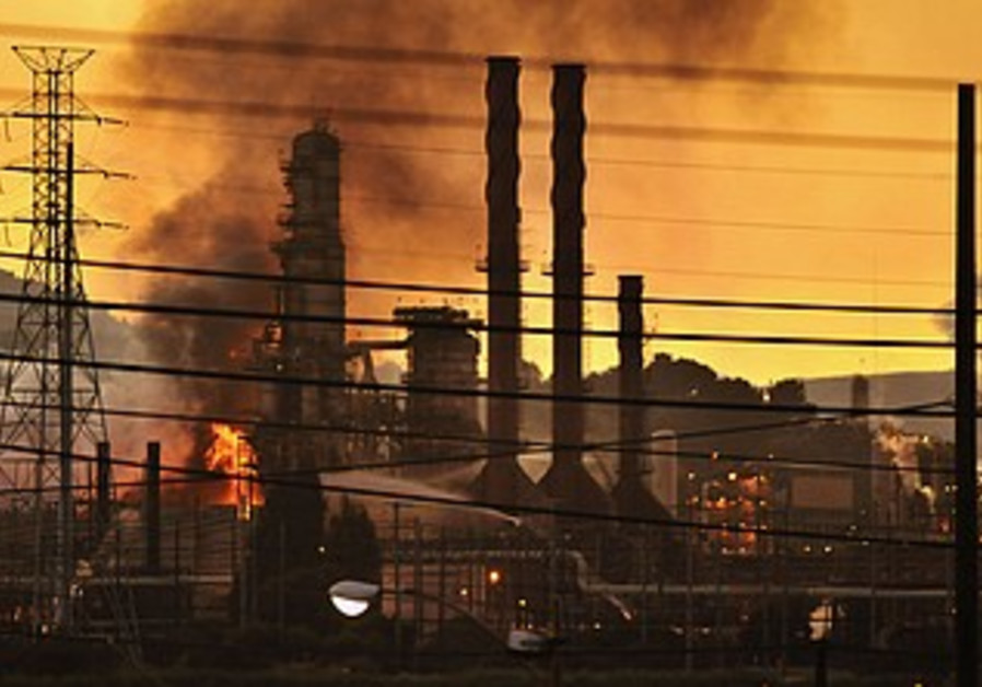 Firefighters douse flames at Chevron oil refinery