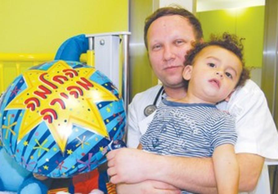 Injured toddler Shai Cohen