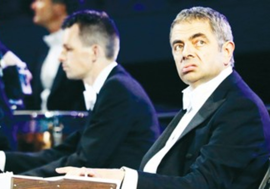 Rowan Atkinson performs at the opening ceremony